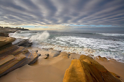 On this morning, I was struck by how the clouds complemented the sandstone formations. So I arranged this scene and waited for a dramatic wave to impact the shoreline.   After I knew that I had captured this scene well, I went hunting for more.