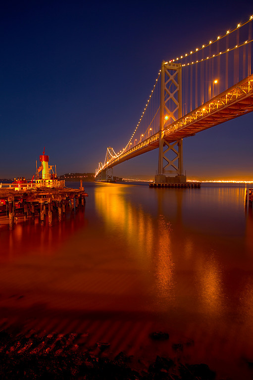 This is a combination of 3 shots all taken at F8 of the 9,260 foot long west span of the San Francisco - Oakland Bay bridge. Exposure times were 10, 50 and 120 seconds each. I created a 32 bit image using Photomatix and then I used tone mapping to make a few small adjustments. But in this case I hardly had to move any sliders, as it looked almost perfect from the start. Then I saved to a 16 bit TIFF.