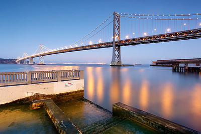 The 10,305 ft long west span of the San Francisco-Oakland Bay Bridge carries 102 million cars per year on its two decks with 5 lanes on each.  Only the George Washington Bridge in New York is busier with 108 million cars per year.
