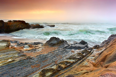 The sunset was turning a brilliant Red during high tide at (the other) Pebble Beach, south of Half Moon Bay.  Then a bank of fog moved in to turn this scene into what a seascape may have looked like hundreds of millions of years ago.  Or, possibly on some alien world, this is a common sight!  Actually it is just alternating layers of red and blue tafoni sandstone.