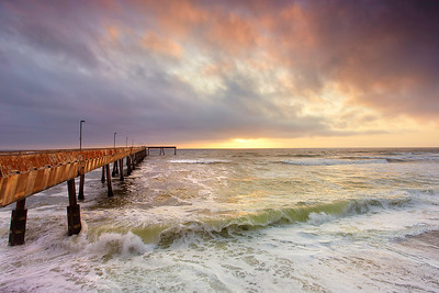 The Pacifica Pier is a great place to watch a sunset. Even on a clear day, there is often a bit of fog here making for dramatic sunsets while elsewhere it is just another bland sunset with blue skies.