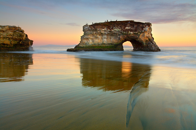 This is another view of Natural Bridges State Park in Santa Cruz, California. I liked the pelicans and the light on the water and rock. Once, these two formations were joined, until a big storm broke them apart back in the 1970's.