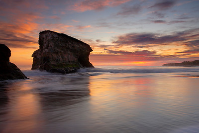 This photo was taken looking north along the beach during sunset at Natural Bridges state park in Santa Cruz. This is a side view of one of the few remaining arches. I chose a medium length exposure in order to show the movement of the water, but not too much. The tripod had to be dug deeply into the sand in order to remain stable as the water rushed by.