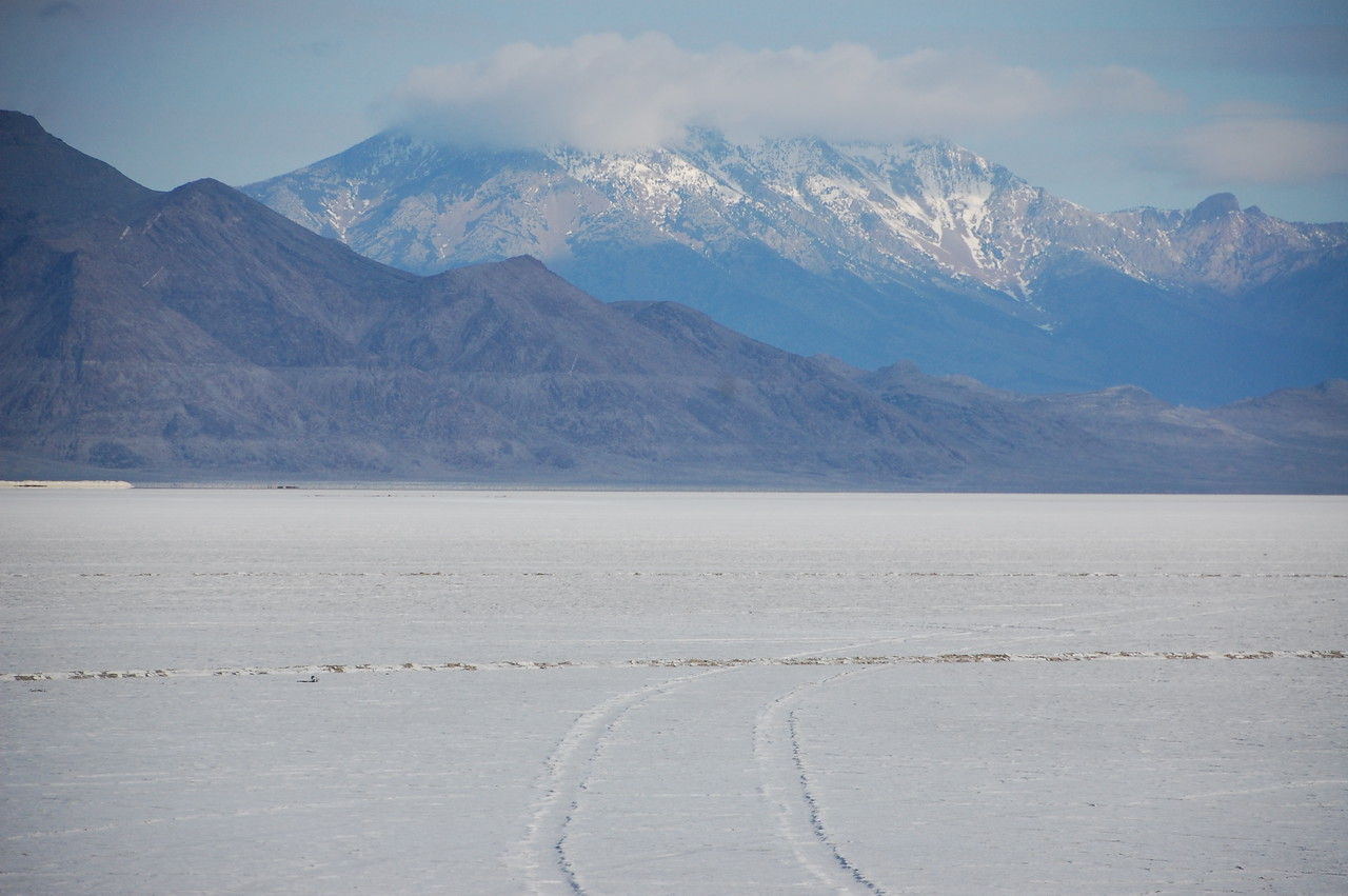 That's not snow on the ground.  It's salt.  Those are the Bonneville (Utah) Salt Flats.  I stopped and licked them (seriously).  They were... salty.