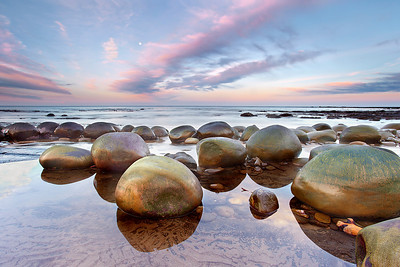 These sandstone concretions at Bowling Ball Beach, a few miles south of Point Arena, California are much like the Moeraki boulders in New Zealand. This is low tide at sunrise, which is good for reflections.