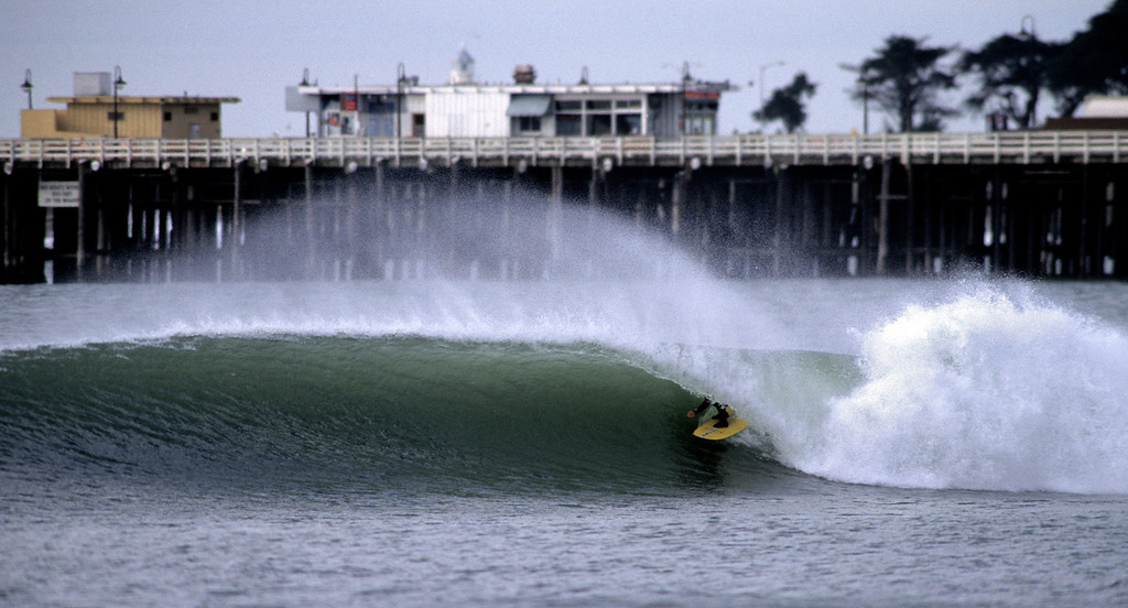 . Michel Junod surfing the San Lorenzo rivermouth in Santa Cruz.  (Vern Fisher - Monterey Herald)