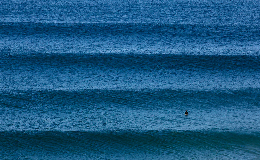 . A surfer enjoying the large surf at Fort Ord Dunes State Park on March 21, 2012.  (Vern Fisher/Monterey Herald)