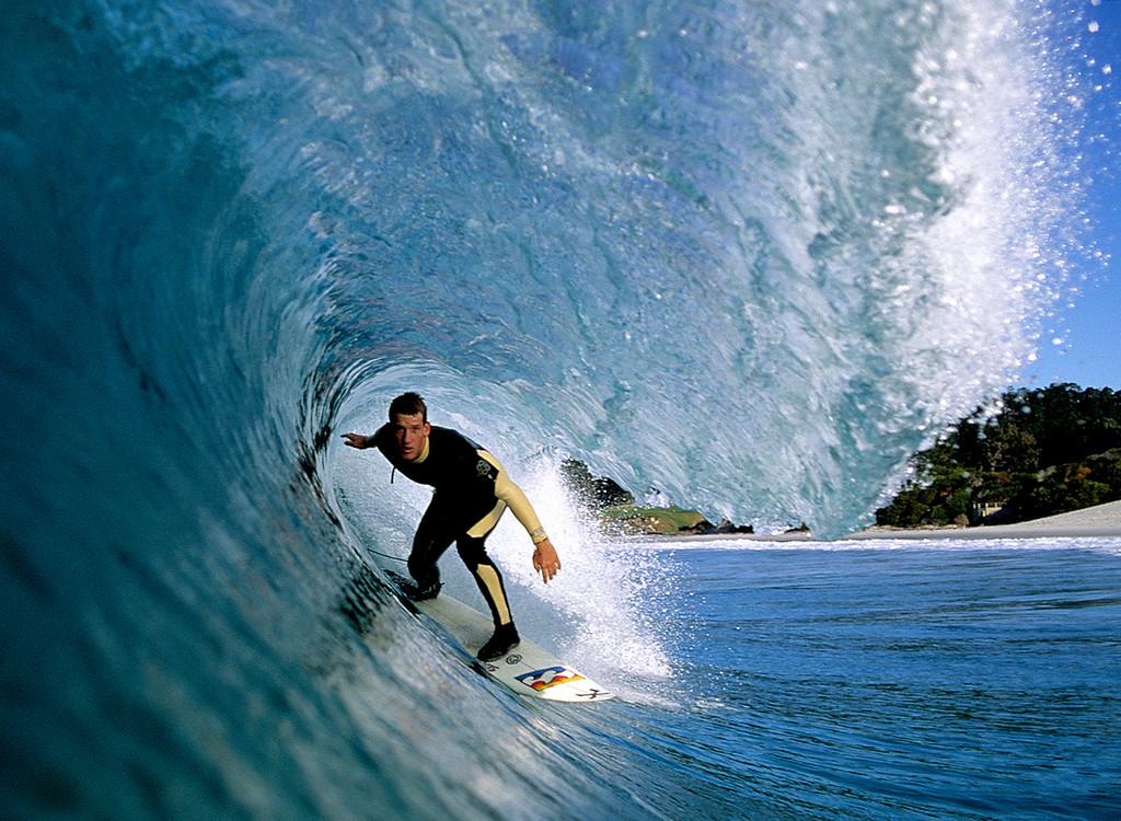 . Nate Acker surfing Carmel Beach.  (Vern Fisher - Monterey Herald)