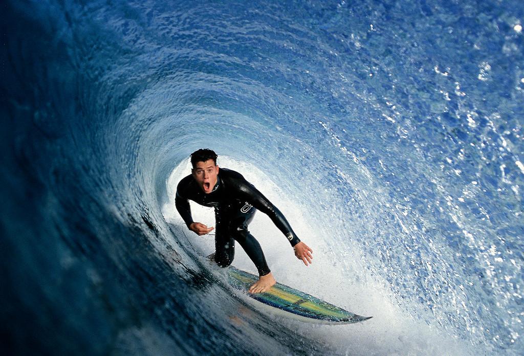 . Homer Henard surfing Carmel Beach.  (Vern Fisher - Monterey Herald)