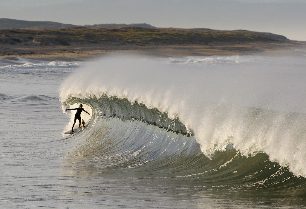 . A surfer surfs a wave in Moss Landing on Friday, Nov. 4, 2016.  (Vern Fisher - Monterey Herald)