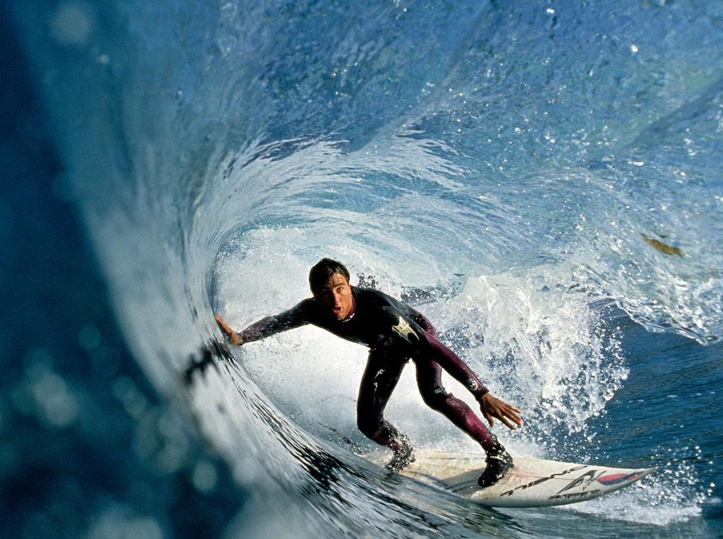 . Josh Mulcoy surfing Carmel Beach.  (Vern Fisher - Monterey Herald)