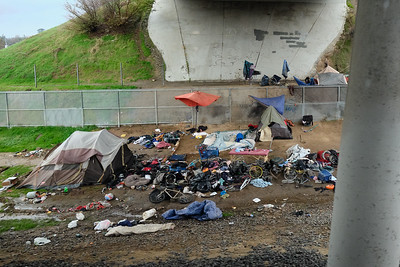 The overpasses and service roads near McClellan Park are home to numerous homeless camps - camps that you would never notice if you weren't on the train.