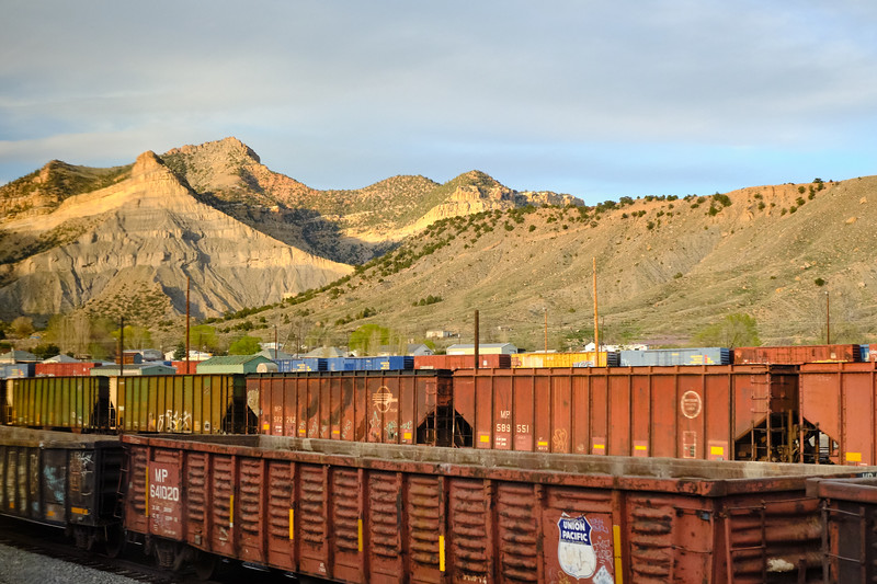 """The massive rail yard at Helper, Utah.  Helper got its name from the """"helper"""" engines that were staged here to help freight trains up the steep grades.  The mine and power plant that supported the town have shut down, and now it struggles to survive.  It has become a haven for artists."""