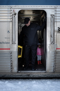 A girl peers out from behind the conductor as the California Zephyr pulls into Truckee.