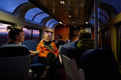 Travelers visiting with each other in the observation car, somewhere between Reno and Winnemucca, Nevada.