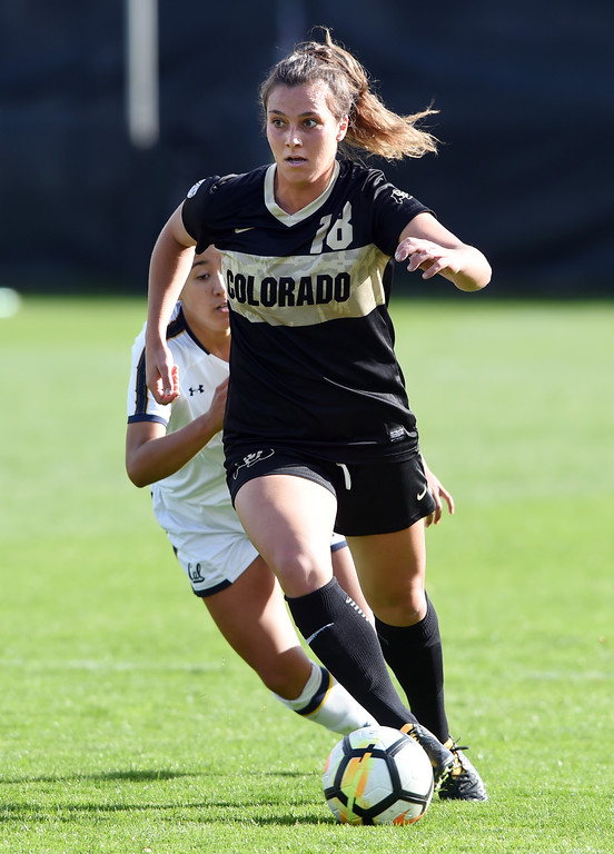 . Cassie Phillips, of CU, gets past a Cal defender during the Buffs game with the Bears on Thursday in Boulder.  Cliff Grassmick / Staff Photographer/ October 5, 2017