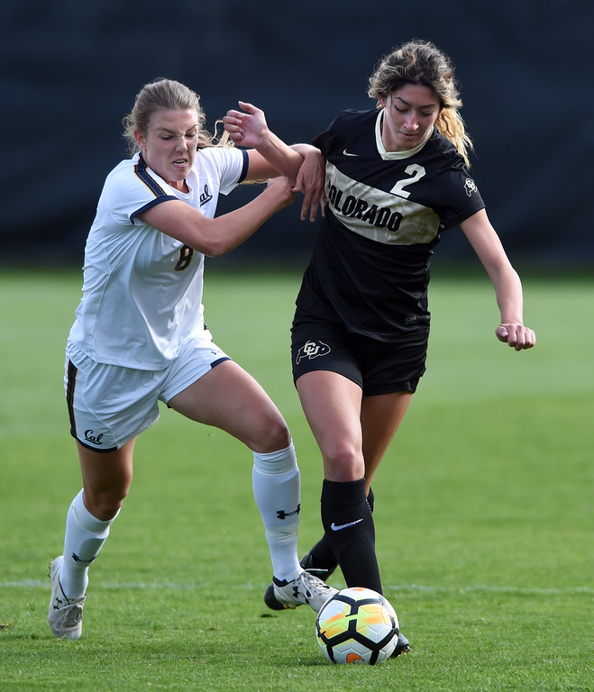 . Emma Westin, left, of Cal, and Joss Orejel, of CU, struggle for control during the Buffs game with the Bears on Thursday in Boulder.  Cliff Grassmick / Staff Photographer/ October 5, 2017