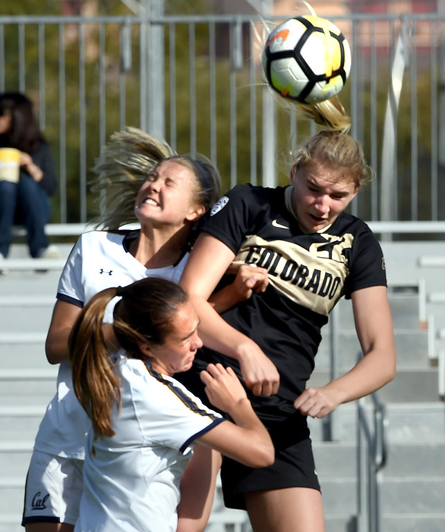 . Taylor Kornieck, right, of CU, goes up against Emily Smith, and Guro Bergsvand, of Cal, during the Buffs game with the Bears on Thursday in Boulder.  Cliff Grassmick / Staff Photographer/ October 5, 2017
