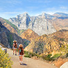 Friends with backpacks on hiking trip on summer vacation ,Girls in high mountains landscape with cloudy sky. Kings Canyon National Park, Fresno, California, USA