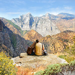 Couple looking at beautiful coastal mountain landscape on hiking trip. Kings Canyon National Park, Fresno, California, USA
