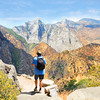 Man with backpack on hiking trip , High mountains landscape with cloudy sky. Kings Canyon National Park, Fresno, California, USA