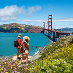 Couple enjoying time together on vacation  trip.  Girls looking at beautiful view of Golden Gate Bridge, over Pacific Ocean. San Francisco, California, USA