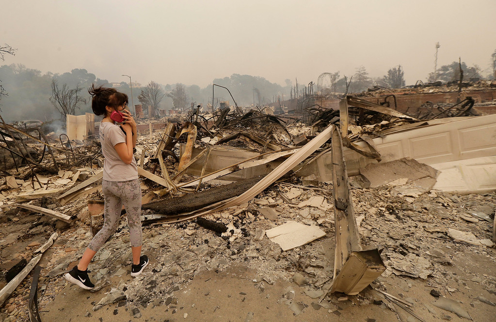 . Tina Renee surveys the damage to a friend\'s house in Santa Rosa, Calif., Monday, Oct. 9, 2017. (AP Photo/Jeff Chiu)
