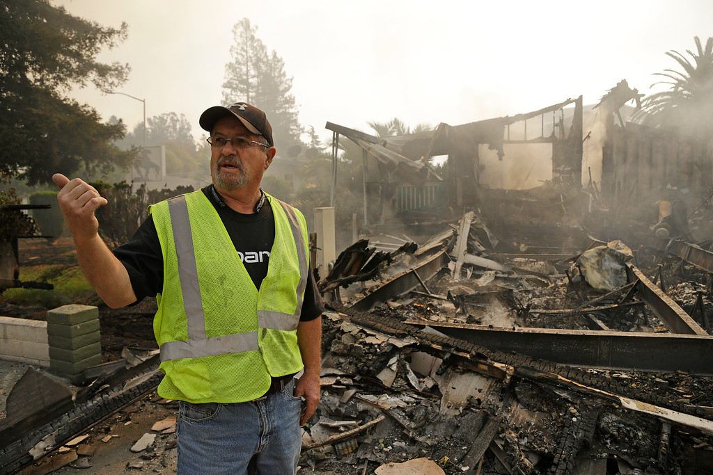 . Jim Cook, manager of the Journey\'s End mobile home park, gestures beside his burnt out home on Monday, Oct. 9, 2017, in Santa Rosa, Calif. Wildfires whipped by powerful winds swept through Northern California early Monday, sending residents on a headlong flight to safety through smoke and flames as homes burned. (AP Photo/Ben Margot)