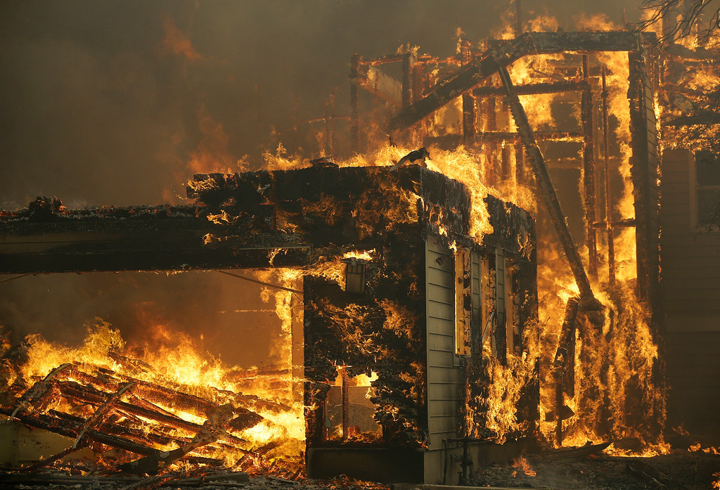 . A house burns in Santa Rosa, Calif., Monday, Oct. 9, 2017. Wildfires whipped by powerful winds swept through Northern California, sending residents on a headlong flight to safety through smoke and flames as homes burned. (AP Photo/Jeff Chiu)