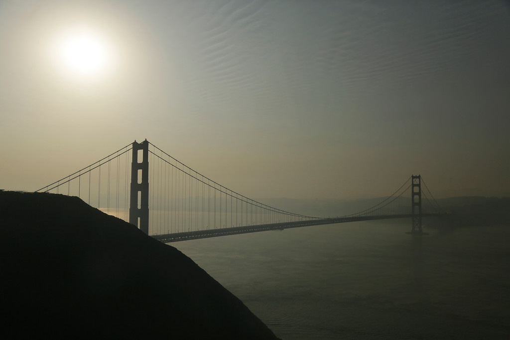 . Smoke from wildfires blankets the Golden Gate Bridge and the San Francisco skyline Tuesday, Oct. 10, 2017, in this view near Sausalito, Calif. An onslaught of wildfires across a wide swath of Northern California broke out almost simultaneously then grew exponentially, swallowing up properties from wineries to trailer parks and tearing through both tiny rural towns and urban subdivisions. (AP Photo/Eric Risberg)