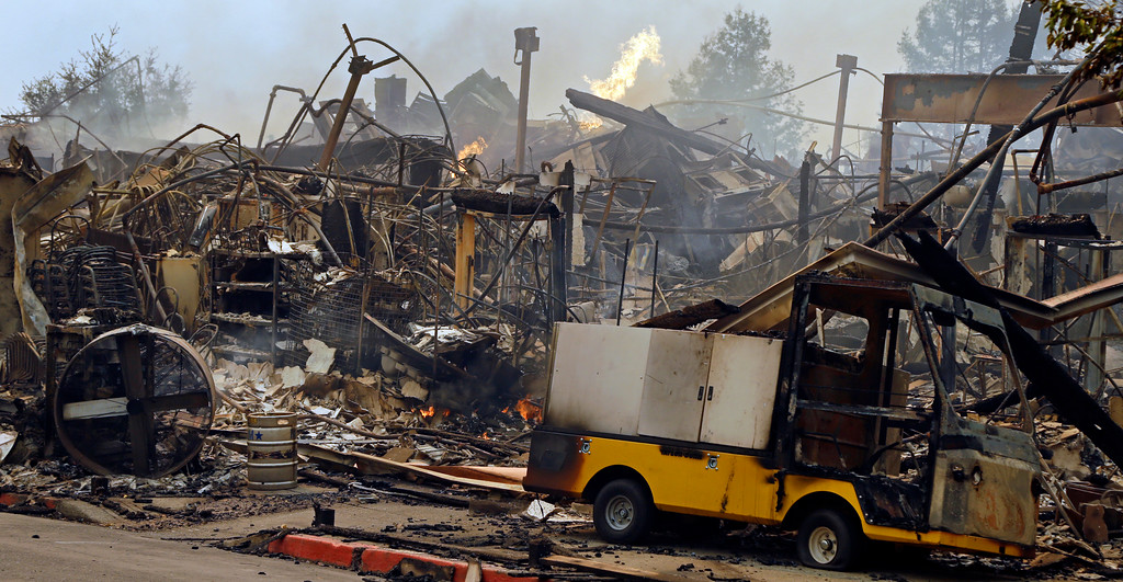 . The Hilton hotel is destroyed Monday, Oct. 9, 2017, in Santa Rosa, Calif. Wildfires whipped by powerful winds swept through Northern California early Monday, sending residents on a headlong flight to safety through smoke and flames as homes burned. (AP Photo/Ben Margot)