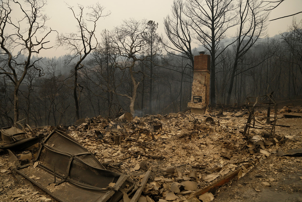 . A fireplace is all that remains of this home on Crystal Road, one of 50 multi million dollar homes destroyed on Monday, Oct. 9, 2017, in Santa Rosa, Calif. Wildfires whipped by powerful winds swept through Northern California early Monday, sending residents on a headlong flight to safety through smoke and flames as homes burned. (AP Photo/Ben Margot)