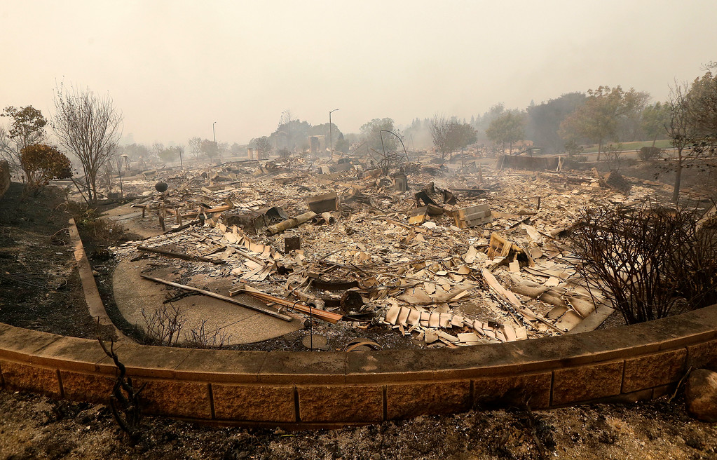 . The remains of burned down homes are shown in Santa Rosa, Calif., Monday, Oct. 9, 2017. Wildfires whipped by powerful winds swept through Northern California early Monday, sending residents on a headlong flight to safety through smoke and flames as homes burned. (AP Photo/Jeff Chiu)