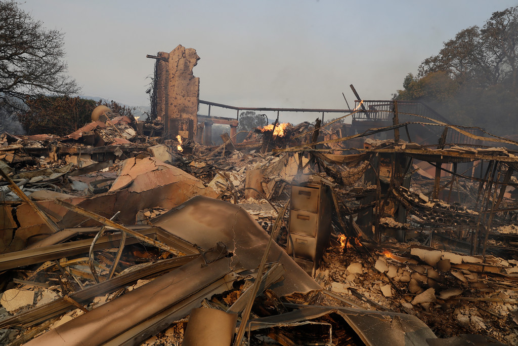 . The charred remains of the Signorello Estate winery are seen Monday, Oct. 9, 2017, in Napa, Calif. Wildfires whipped by powerful winds swept through Northern California sending residents on a headlong flight to safety through smoke and flames as homes burned. (AP Photo/Marcio Jose Sanchez)