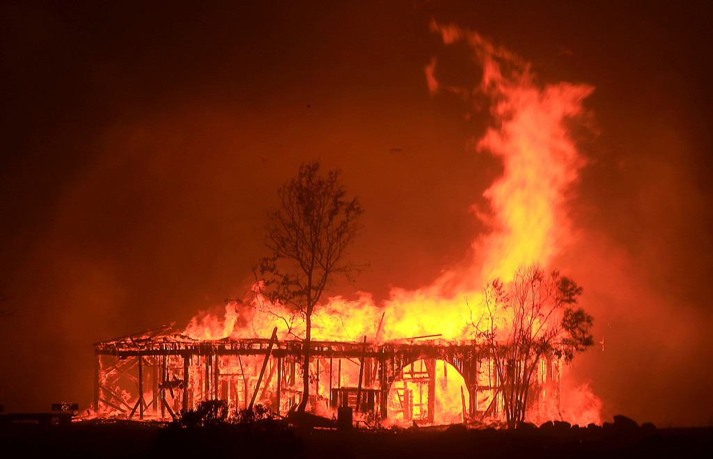 . The Historic Round Barn burns, Monday Oct. 9, 2017, in Santa Rosa, Calif. More than a dozen wildfires whipped by powerful winds been burning though California wine country. The flames have destroyed at least 1,500 homes and businesses and sent thousands of people fleeing. (Kent Porter/The Press Democrat via AP)