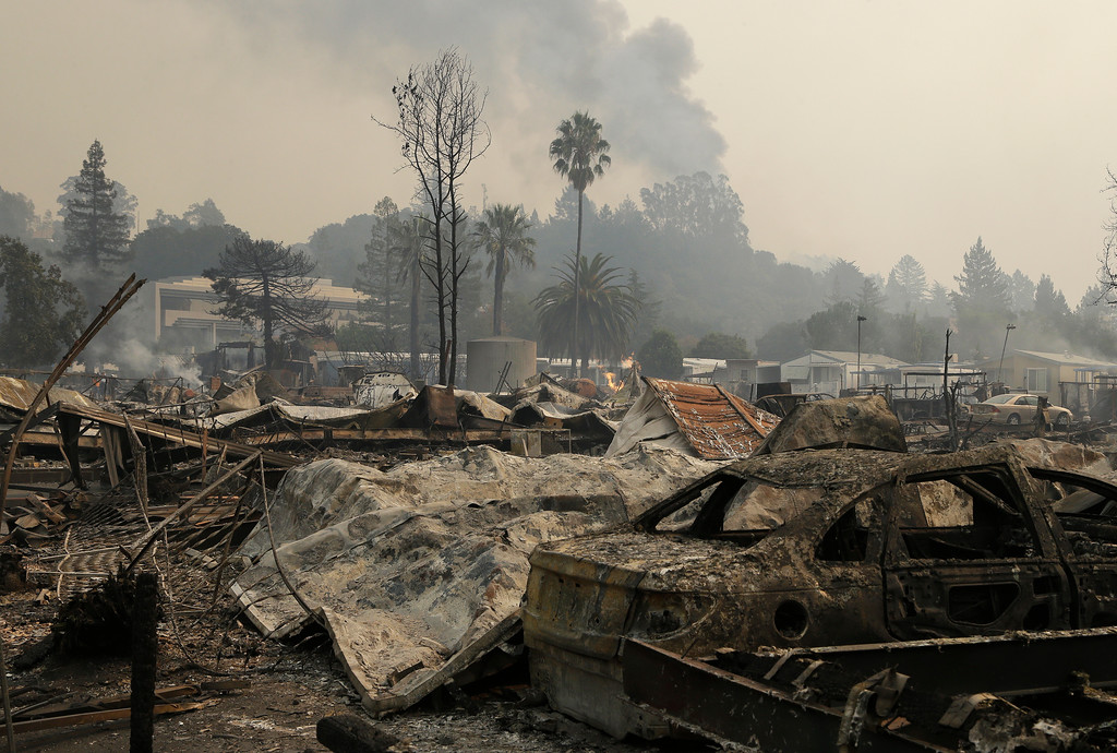 . Remains from a wildfire sit at the Journey\'s End mobile home park on Monday, Oct. 9, 2017, in Santa Rosa, Calif. Wildfires whipped by powerful winds swept through Northern California early Monday, sending residents on a headlong flight to safety through smoke and flames as homes burned. (AP Photo/Ben Margot)