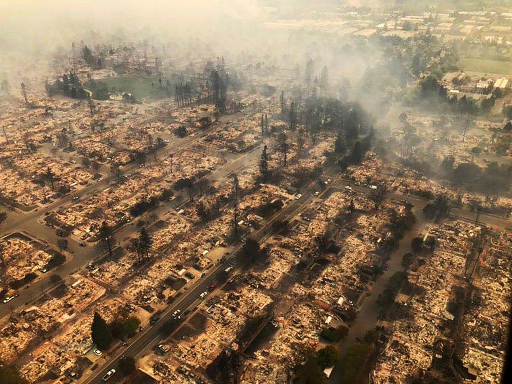 . This aerial photo provided by the California Highway Patrol Golden Gate Division shows some of hundreds of homes destroyed in a wind-driven wildfire that swept through Santa Rosa, Calif., early Monday, Oct. 9, 2017. (California Highway Patrol Golden Gate Division via AP)