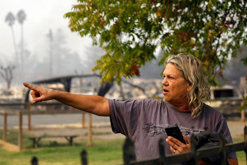 . Jim Cook, manager of the Journey\'s End mobile home park, points to damage on the property Monday, Oct. 9, 2017, in Santa Rosa, Calif. Wildfires whipped by powerful winds swept through Northern California, sending residents on a headlong flight to safety through smoke and flames as homes burned. (AP Photo/Ben Margot)