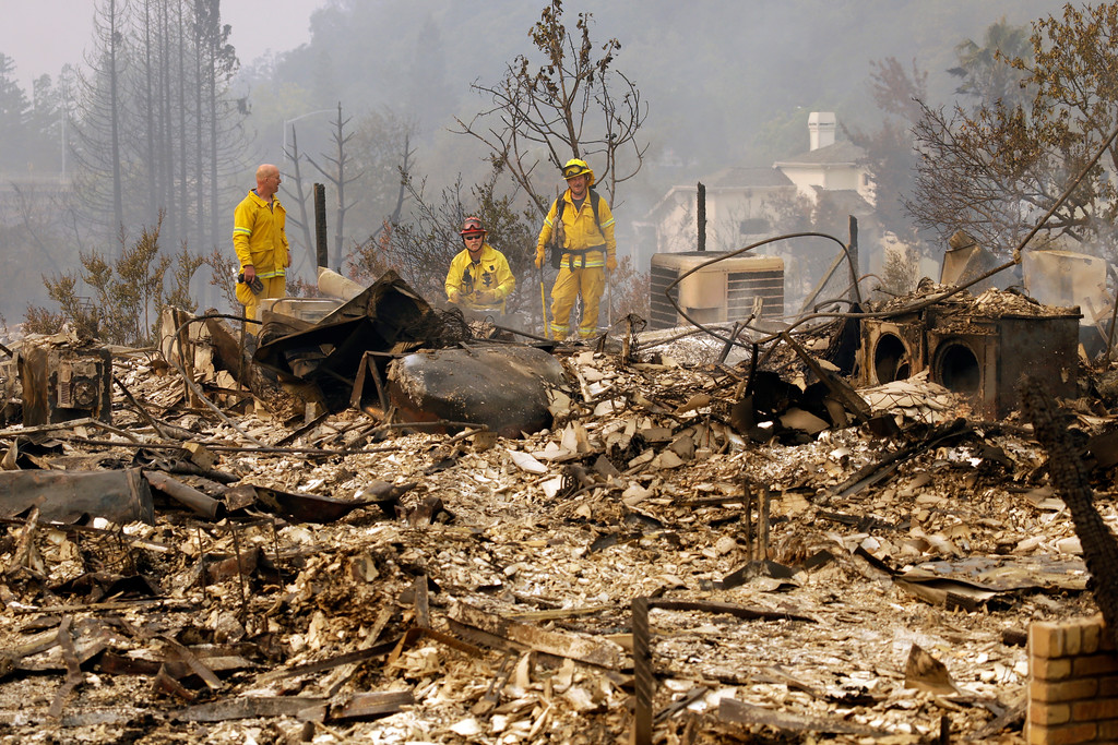 . Firemen look for hot spots in the Fountaingrove area of Santa Rosa, Calif., on Monday, Oct. 9, 2017. Wildfires whipped by powerful winds swept through Northern California early Monday, sending residents on a headlong flight to safety through smoke and flames as homes burned. (AP Photo/Ben Margot)