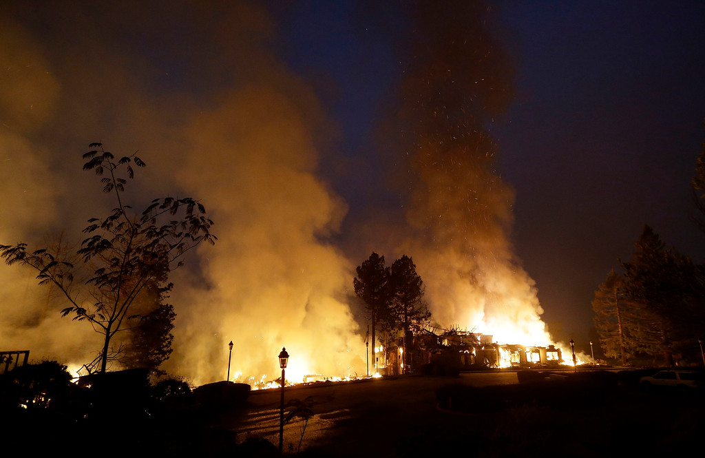 . Smoke and flames from fire at the Hilton Sonoma Wine Country hotel in Santa Rosa, Calif., Monday, Oct. 9, 2017. (AP Photo/Jeff Chiu)