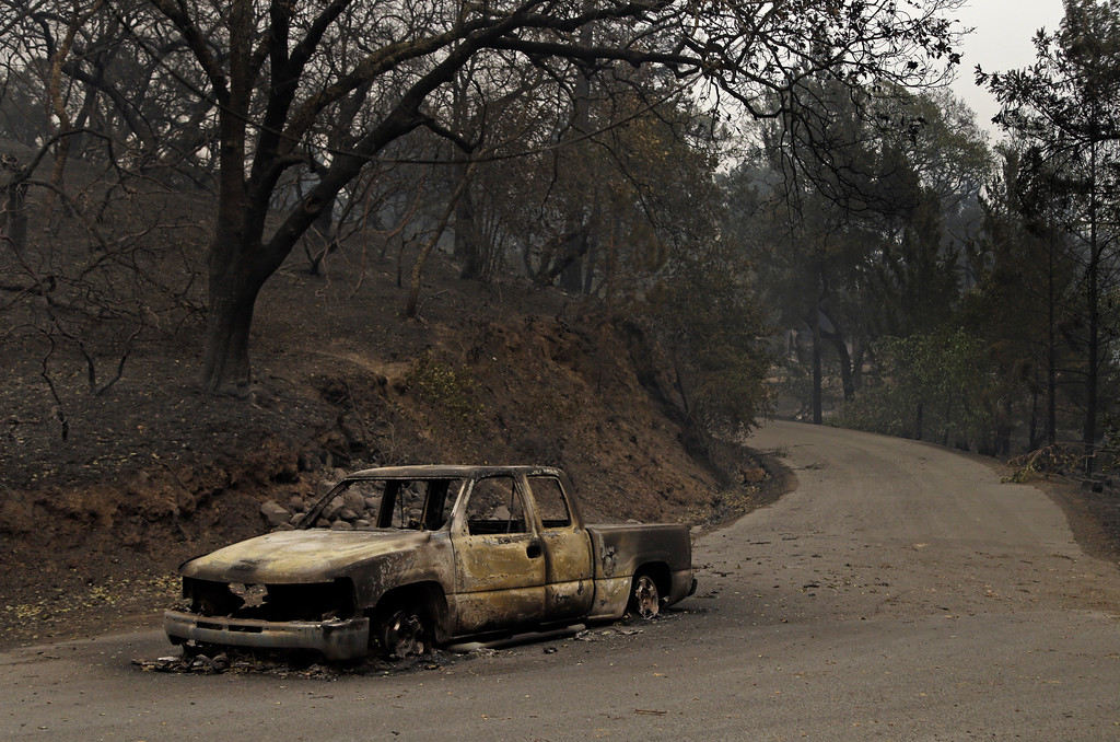 . Remains of a car seen on Crystal Drive Monday, Oct. 9, 2017, in Santa Rosa, Calif. Wildfires whipped by powerful winds swept through Northern California early Monday, sending residents on a headlong flight to safety through smoke and flames as homes burned. (AP Photo/Ben Margot)