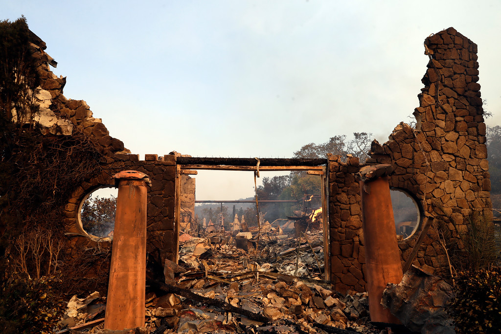 . The entrance to the fire-ravaged Signorello Estate winery is seen Monday, Oct. 9, 2017, in Napa, Calif. (AP Photo/Marcio Jose Sanchez)