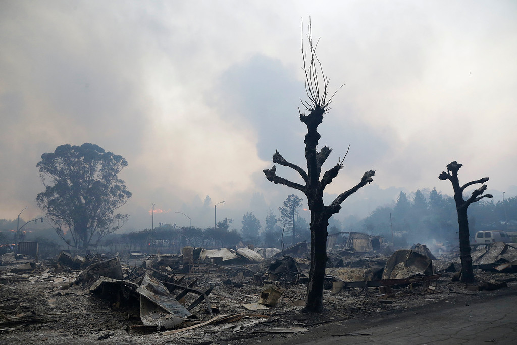 . Charred remains sit at Journey\'s End mobile home park in Santa Rosa, Calif., Monday, Oct. 9, 2017. Wildfires whipped by powerful winds swept through Northern California sending residents on a headlong flight to safety through smoke and flames as homes burned. (AP Photo/Jeff Chiu)