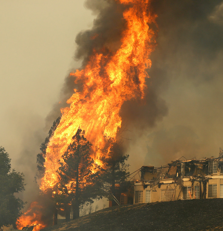. Fire continues to rage at the Hilton hotel on Monday, Oct. 9, 2017, in Santa Rosa, Calif. Wildfires whipped by powerful winds swept through Northern California early Monday, sending residents on a headlong flight to safety through smoke and flames as homes burned. (AP Photo/Ben Margot)