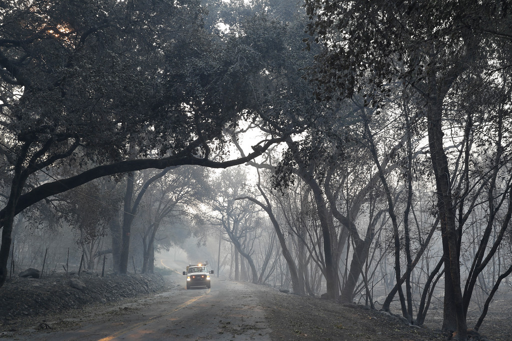 . An emergency vehicle makes its way along a fire-ravaged Soda Canyon Rd., Monday, Oct. 9, 2017, in Napa, Calif. (AP Photo/Marcio Jose Sanchez)
