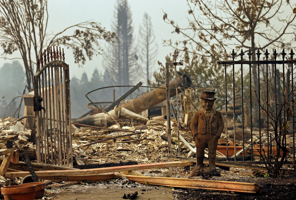 . Destruction in the Fountaingrove area on Monday, Oct. 9, 2017, in Santa Rosa, Calif. Wildfires whipped by powerful winds swept through Northern California early Monday, sending residents on a headlong flight to safety through smoke and flames as homes burned. (AP Photo/Ben Margot)