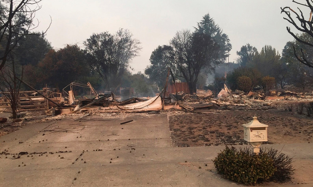 . This Monday, Oct. 9, 2017, photo provided by Dominic Foppoli shows Jeff Okrepki\'s house leveled by a wildfire that tore through the Coffey Park subdivision of Santa Rosa, Calif. State authorities are deploying more firefighters and law enforcement officials to areas devastated by wildfires raging in Northern California. (Dominic Foppoli via AP)