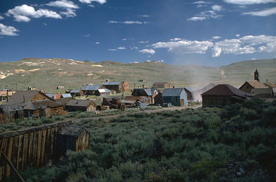 Dust swirls through the streets of Bodie
