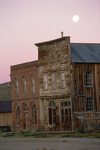 Bodie store fronts with full moon rising
