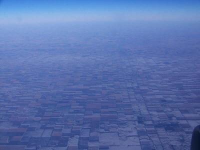 snowy farm fields in Kansas, from the air